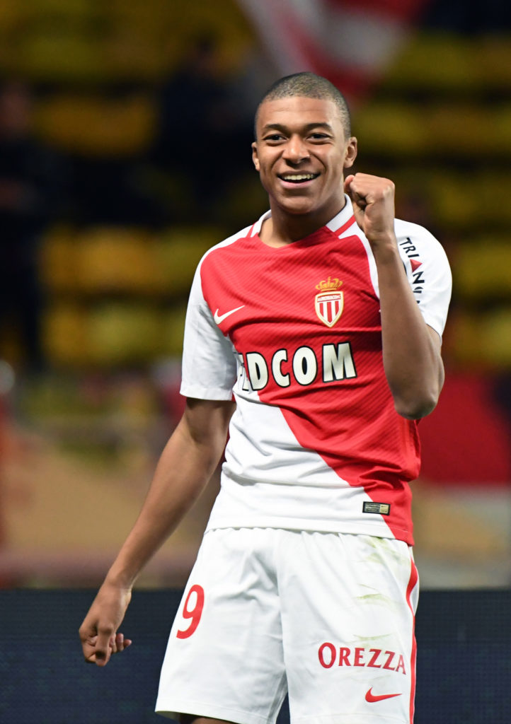 Monaco's French forward Kylian Mbappe Lottin celebrates after scoring a goal during the French Ligue 1 football match between AS Monaco and Metz (FCM) at the Louis II Stadium in Monaco on February 11, 2017.  / AFP PHOTO / Yann COATSALIOU